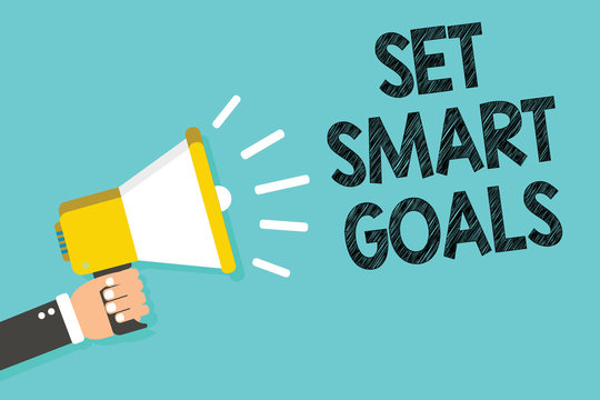 Writing note showing Set Smart Goals. Business photo showcasing Establish achievable objectives Make good business plans Man holding megaphone loudspeaker blue background message speaking
