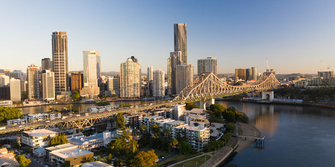 Brisbane City Bridge sunrise view over cbd, river and buildings. Aerial, helicopter shot