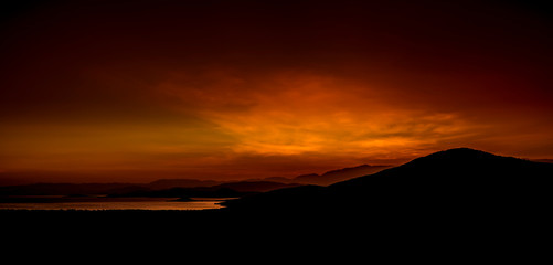 First glow in the clouds before dawn over Nechisar National Park and Abaya Lake in Ethiopia.
