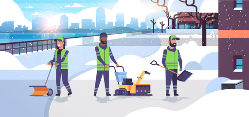 cleaners team using different equipment and tools snow removal concept mix race men women in uniform cleaning urban residential area cityscape background flat full length horizontal