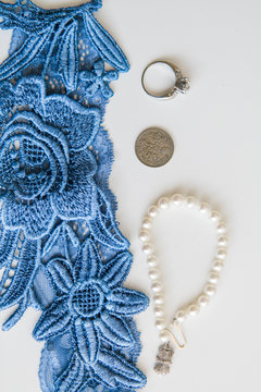 Something old, new, borrowed, blue wedding detail shot, lace garter, pearl bracelet , sixpence coin, wedding ring
