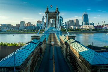 Panoramic view of Cincinnati downtown with the historic Roebling suspension bridge over the Ohio...