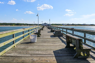 A view towards the shore on the Ocean View fishing pier in Norfolk, Virginia.