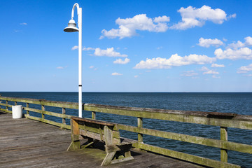 A bench on the Ocean View fishing pier in Norfolk, Virginia.