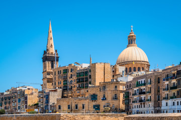 Fotomurales - View of cathedral and belltower in old city centre of Valletta, Malta.