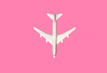 Model plane, airplane on pink pastel color background with copy space.Flat lay design.Travel concept on pink background. top view model plane on pink color background. Wall mural