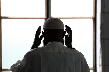 A Muslim man prays at Al Abrar mosque in Goma