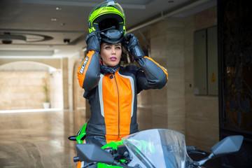 Baran Hadizadeh, a female biker wears her motorcycle helmet in Tehran