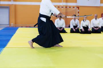 People in kimono on martial arts weapon training seminar