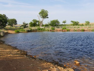 Medium wide view of Lake Elmer Thomas near the parking lot at the Wichita Mountains, Oklahoma