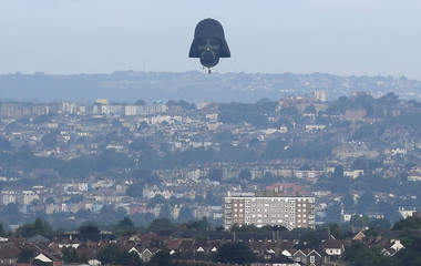 A balloon shaped as the head of fictional Star Wars film character Darth Vader is seen flying at the annual Bristol hot air balloon festival in Bristol, Britain