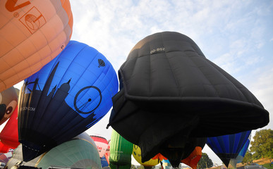 Balloons, including one shaped as the head of fictional Star Wars film character Darth Vader, launch during a mass take off at the annual Bristol hot air balloon festival in Bristo