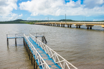 Pier and bridge that connects Itamaraca Island with the mainland over the Santa Cruz Canal - Pernambuco, Brazil