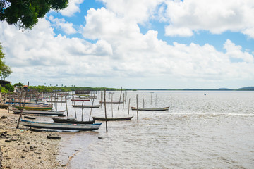 "Itapissuma, Brazil - Circa August 2019: Typical fisherman's boats called ""baitera"" by the shore in Itapissuma, Pernambuco"