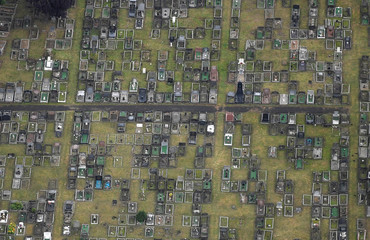 Graves are seen in a cemetery from the air during a mass take off at the annual Bristol hot air balloon festival in Bristol