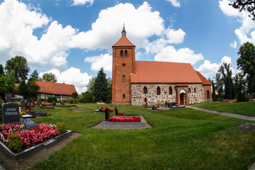 Old authentic brick church in a village