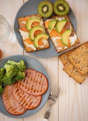 Roast pork ham and salmon and avocado sandwiches