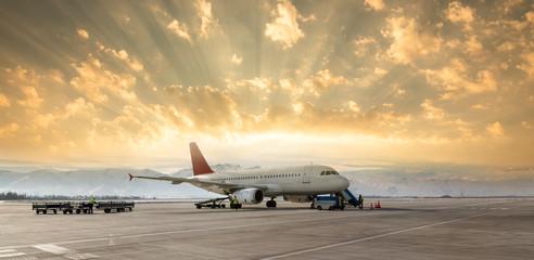 Loading cargo plane at evening sunset - fototapety na wymiar