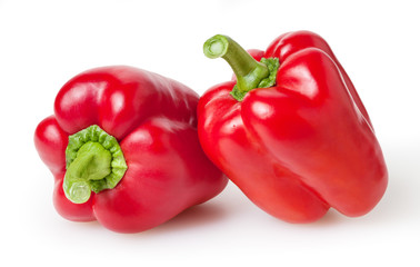Fresh red bell peppers isolated on white background with clipping path