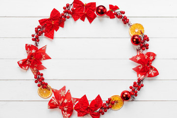 Christmas banner. Circle made of christmas decor pieces on a white wooden background