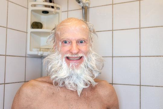 happy senior bearded man taking shower