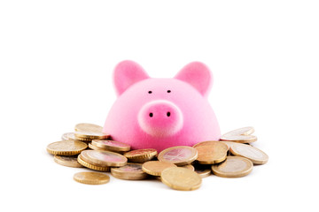 Pink piggy bank with euro coins on white background