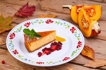homemade pumpkin pie on the wooden background
