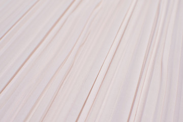 The texture of the synthetic fabric is pink. Background, pattern.