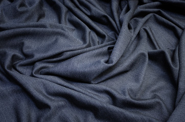 The texture of the silk fabric is gray. Knitwear Background, pattern.