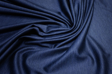 The texture of cashmere with silk is dark blue. Background, pattern.