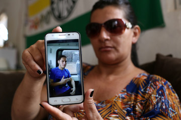 Odijane Mota shows a picture of her son during an interview with Reuters in Altamira