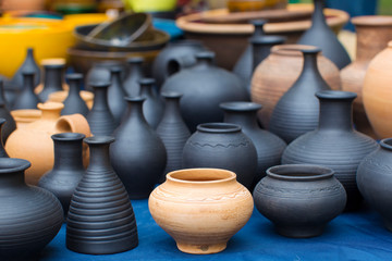 Clay vessels of different colors. Ceramics Fototapete