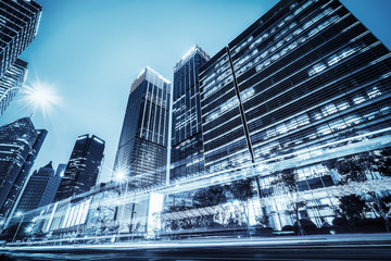 the light trails on the modern building background Fotomurales