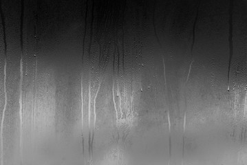 Real glass Window with steam and condensation on surface raining Night