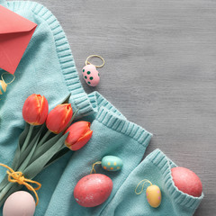 Easter flat lay on grey textured wooden background with copy-space