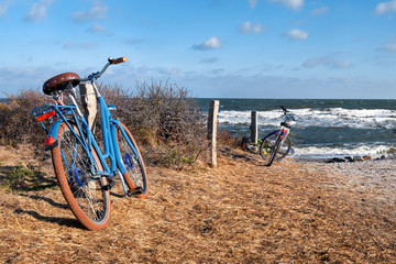 Bikes by the entrance to the beach on island Hiddensee, Baltic sea, Northern Germany, panorama