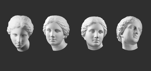 Four gypsum copy of ancient statue Venus head isolated on black background. Plaster sculpture woman face. Fotoväggar