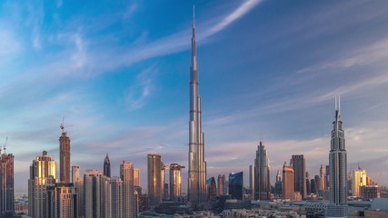 Papiers peints Dubai Dubai Downtown skyline timelapse with Burj Khalifa and other towers during sunrise paniramic view from the top in Dubai