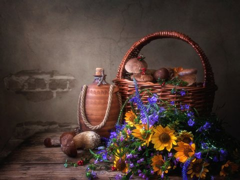 Still life with mushrooms and bouquet wild flowers