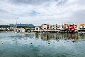 View of the promenade and houses against the mountains in Rethymno in Greece.