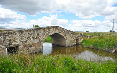 Medieval bridge of Bencaliz near the village of Aldea del Cano, province of Cáceres, Spain. Through it cross the pilgrims who walk along the Vía de la Plata towards Santiago de Compostela.