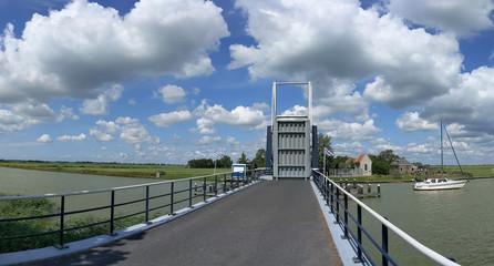 Bridge open for a sailboat in Friesland