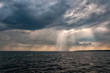 Dramatic sea landscape with sun beams