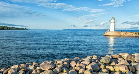 Swedish lake landscape with white lighthouse