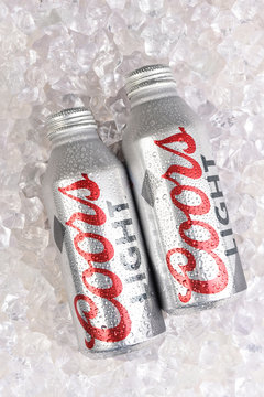 IRVINE, CALIFORNIA - APRIL 15, 22019: Two Coors Light Aluminum Pint Bottles in a bed of ice