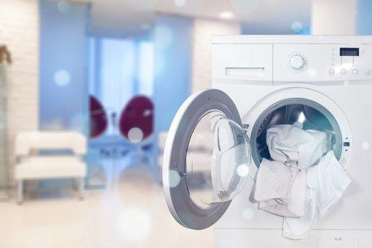 Washing machine with laundry on background