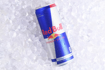 IRVINE, CALIFORNIA - MAY 23, 2018: A single can of Red Bull Energy Drink on ice. Red Bull is the most popular energy drink in the world.