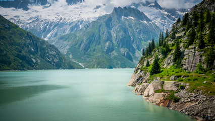 Beautiful lake in the glaciers of the Swiss Alps - nature of Switzerland