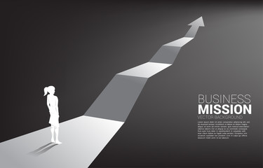 Silhouette of businesswoman standing on growth graph arrow. Concept of career path and start business