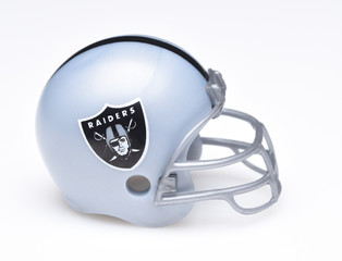 IRVINE, CALIFORNIA - AUGUST 30, 2018: Mini Collectable Football Helmet for the Oakland Raiders of the American Football Conference West.